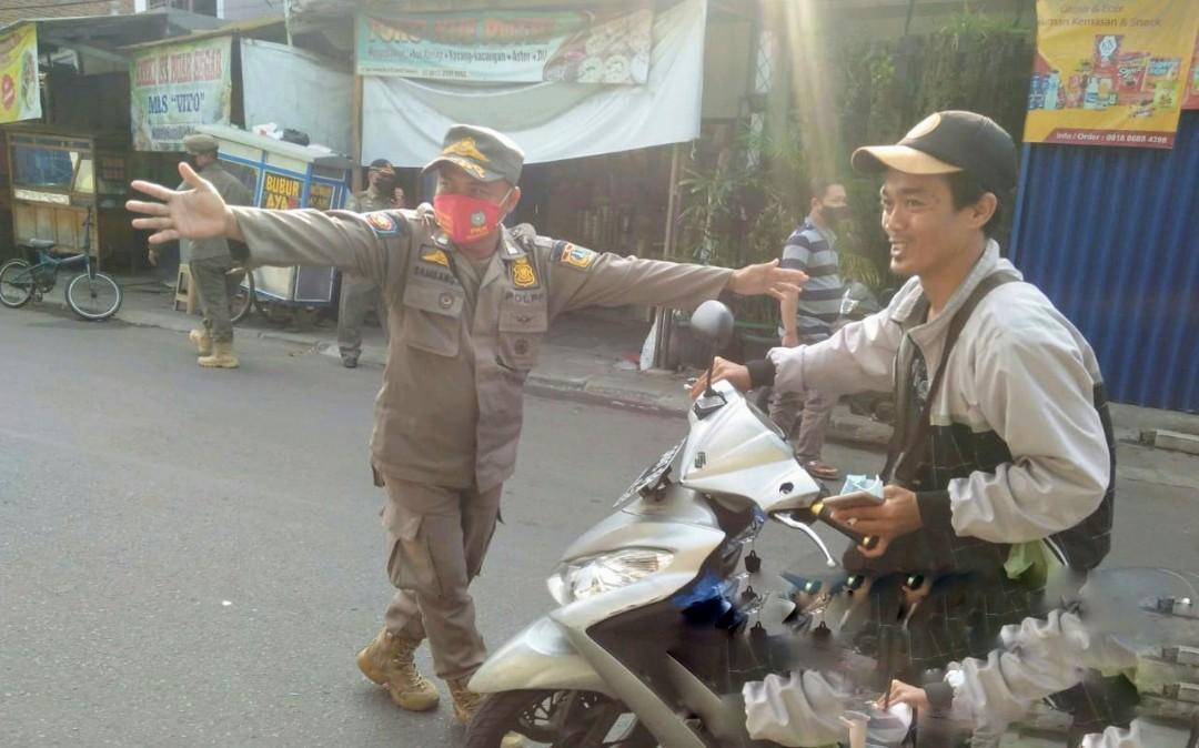 Melintas Jalan Tipar Cakung Tidak Bermasker, Sebanyak 33 Orang Diberikan Sanksi Sosial